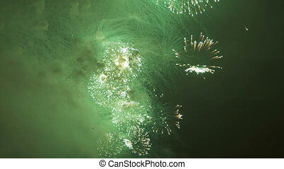 A view of a beautiful firework from the deck of a ship that floats along the river.