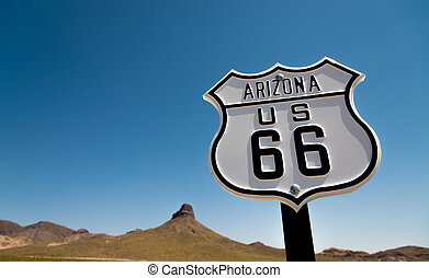A view of a historic Route 66 sign with a sky blue background
