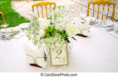 A view of a round banquet table with napkins and silverware ...