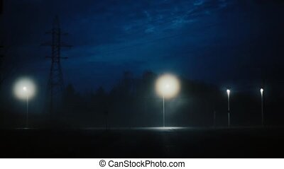 A view of amazing dark night highway with traffic. Stunning mysterious cinematic shot. Scenic moving fog in city lights.