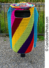 colorful knitting covering a trash can