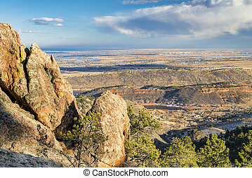 a view of Colorado foothills and Loveland from Horsetooth Rock trail, snowless winter scenery