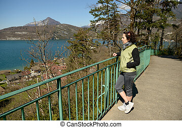 view of Lake Annecy with a woman standing