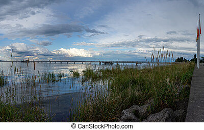 view of Lake Constance with the pier at Altnau in evening light