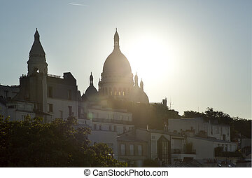 sacre coeur - a view of sacre coeur at sunrise