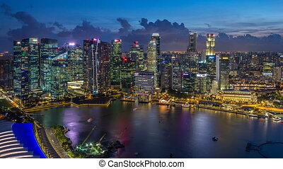 A view of Singapore business district skyscrapers at evening with water reflections day to night timelapse