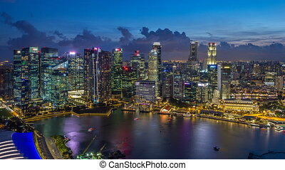 A view of Singapore business district skyscrapers at evening...