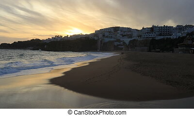 View of the beach at Albuferie, Portugal at sunset