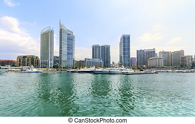 A view of the beautiful Marina in Zaitunay Bay in Beirut, Lebanon. A very modern, high end and newly developed area where yachts are embarked and it's perfect for a waterfront promenade.