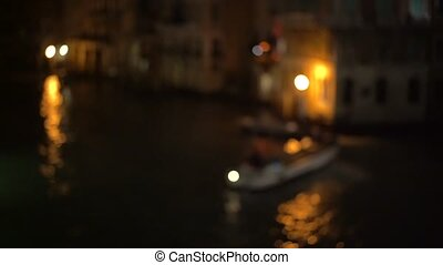A view of the canal at night. Venice, Italy - View of a...