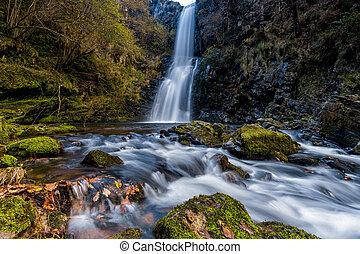 view of the Cascada de Cioyo waterfalls in Asturias in late autumn