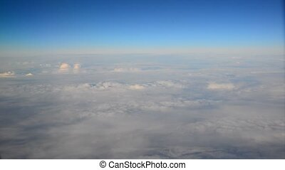 view of the clouds from the plane