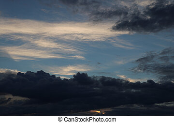 A view of the dark clouds during sunset