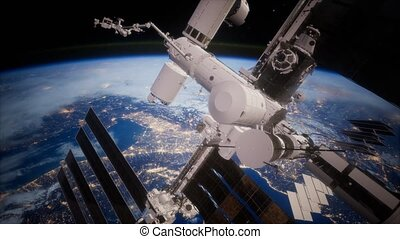 A view of the Earth and a spaceship. ISS is orbiting the...