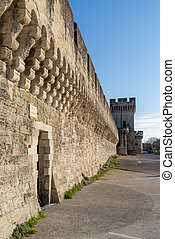 the historic city wall in the old town of Avignon