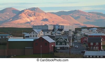 A view of the Icelandic town surrounded by mountains. Andreev.