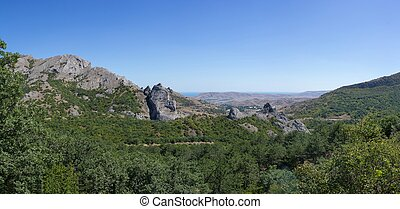 A view of the mountains in a cloudless summer day. Mountain landscape.