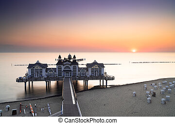 view of the Sellin pier on Ruegen Island on the Baltic Sea at sunrise