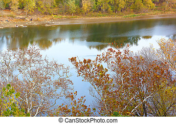 A view on Potomac River banks in autumn. Sunset near Potomac River in Washington DC.