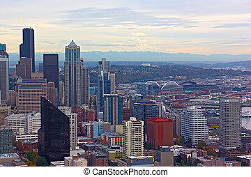 A view on Seattle downtown and Mount Rainier at autumn sunset.