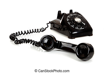 A vintage black telephone on a white background