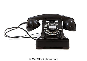 A vintage, black telephone on a white background