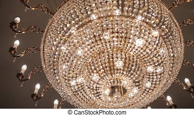 A Vintage Chandelier on white ceiling in old castle - An old...