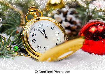 A vintage clock in the snow against the background of a Christmas tree and a garland