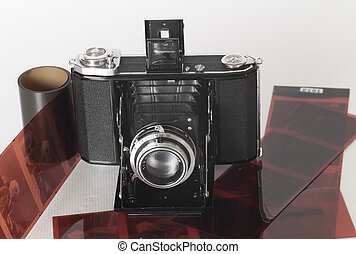 A vintage folding camera with some film