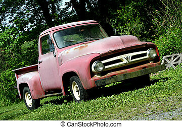 Vintage red pickup truck - A Vintage red pickup truck