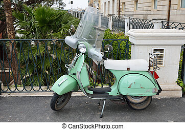 A vintage scooter in the ancient city Syracuse