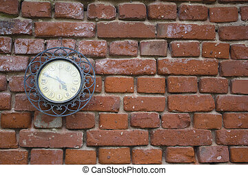 A Vintage Station Clock On A Red Brick Wall
