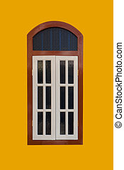 A vintage window on yellow wall