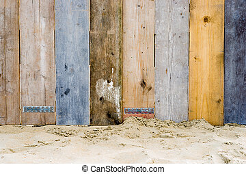 a vintage wooden fence - A fence on a beach made from wood...