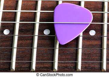guitar pick - a violet guitar pick close up, shallow dof