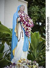 A Virgin Mary statue at Maria Lanakila Catholilc Church in Lahaina, Maui, Hawaii
