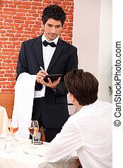 a waiter working at restaurant