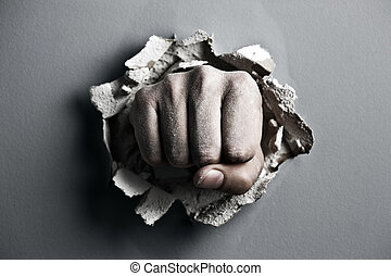 fist - a wall is broken through by a fist