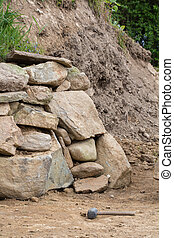 A wall of stones in the garden
