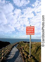 slippery cliff edge walk