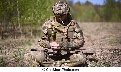 A warrior or military soldier dressed in camouflage, a...
