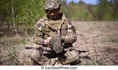 A warrior or military soldier dressed in camouflage...