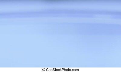 a water drop falling in blue water