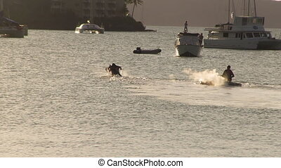 A water jet pack and a jet ski - A long shot of a man on a...