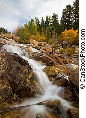 A waterfall flows in Rocky Mountain National Park in...