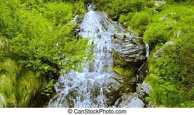 A waterfall in the Swiss mountains. Canton of Tessin.