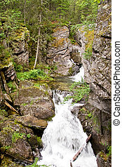 A waterfall is in the Ural mountains 2