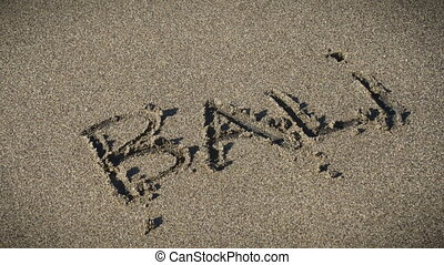 sea wave wash away written summer word on the sand stock footage