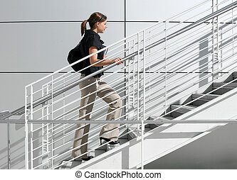 A way to success - A girl college student walking up the ...
