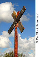A weather worn old railroad crossing sign